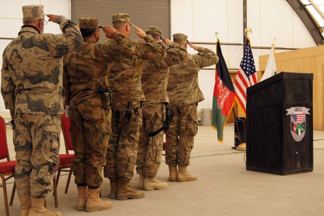 Representatives from the Afghan Border Police, Pakistan army and U.S. Army render honors to their respective nation flags during the Joint Border Coordination Center transfer of authority ceremony at Forward Operating Base Spin Boldak, Afghanistan, Jan. 7, 2012. The 27th Infantry Brigade Combat Team from New York Army National Guard relinquished authority to the 208th Army Liaison Team from Fort Carson, Colo.