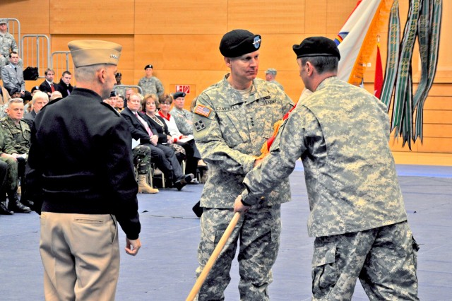 Adm. James G. Stavridis (left), EUCOM commander, looks on as Lt. Gen. Donald M. Campbell Jr. hands the USAREUR colors to Command Sgt. David S. Davenport during the USAREUR Assumption of Command Ceremony Jan. 9.