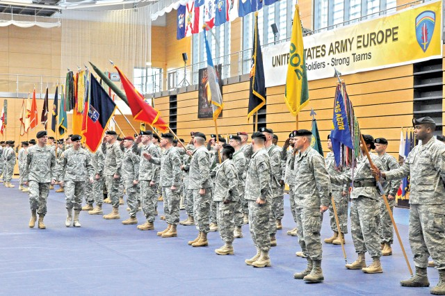 Maj. Gen. James C. Boozer (left) accompanies Lt. Gen. Donald Campbell Jr. as he inspects the troops during the ceremony in the Wiesbaden Fitness Center.