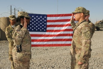 Lt. Col. Deborah M. Ellis, commander of the 502d Military Intelligence Battalion, conducts an indefinite reenlistment ceremony for Staff Sgt. Marlon M. Clark, a signal intelligence analyst from Denver, Colo., assigned to A Co. 502d MI Battalion, Jan....