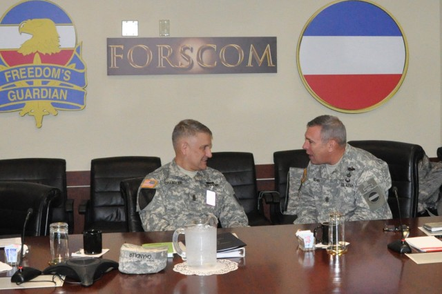 Sgt. Maj. of the Army Raymond F. Chandler III (left) and Sgt. Maj. Darrin J. Bohn, U.S. Army Forces Command sergeant major, have a discussion prior to the beginning of the Sergeant Major of the Army Board of Directors meeting.