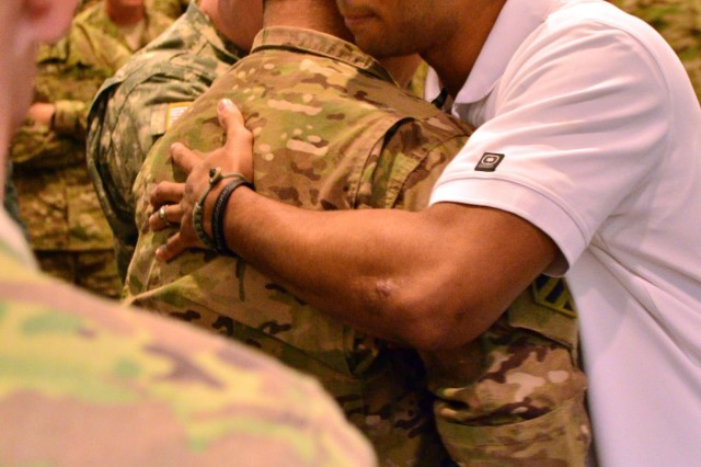 Months-long wait ends for infantryman reunited with comrades
