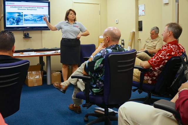 Renee' Van Slate, Lead Humanitarian Assistance Advisor to Pacific Command and a member of the  Office of U.S. Foreign Disaster Assistance (OFDA) Military Liaison Team (MLT) speaks to servicemembers during the Joint Humanitarian Operations Course at Joint Base Pearl Harbor-Hickam Jan. 11. The course is presented quarterly by OFDA and is designed to educate servicemembers on the role of U.S. government and the military when dealing with disaster relief events.  The course combined presentations about the structure of U.S. and foreign relief agencies, their practices and procedures and also included practical exercises to put servicemembers in the shoes of OFDA personnel.  Twenty members of the U.S. Army Pacific Contingency Command Post (CCP) attended the class, held 7-8 Jan. and again 10-11 Jan.  JHOC is a requirement for all CCP personnel.  The CCP consists of more than ninety personnel with the specific skills to provide a USARPAC forward command post capability, specifically focusing on small scale contingencies such as supporting humanitarian assistance, disaster relief and peace operations.  The CCP can tailor personnel and equipment to fit the mission with a team as small as seven, to as many as more than one hundred twenty servicemembers with augmenting forces.