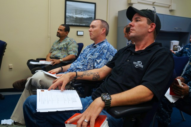 Chief Warrant Officer 3 (promotable) James Lively (right) and Lt. Col. Michael Brophy (Center), both Aviation Officer's with the U.S. Army Pacific Contingency Command Post (CCP) listen to instructors during the Joint Humanitarian Operations Course at Joint Base Pearl Harbor-Hickam Jan. 11. The course is presented quarterly by the Office of U.S. Foreign Disaster Assistance (OFDA) Military Liaison Team and is designed to educate servicemembers on the roles of the U.S. government and the military when dealing with disaster relief events.  The course combined presentations about the structure of U.S. and foreign relief agencies their practices and procedures and also included practical exercises to put servicemembers in the shoes of OFDA personnel.  Twenty members of the U.S. Army Pacific Contingency Command Post (CCP) attended the class, held  7-8 Jan. and again 10-11 Jan.  JHOC is a requirement for all CCP personnel.  The CCP consists of more than ninety personnel with the specific skills to provide a USARPAC forward command post capability, specifically focusing on small scale contingencies such as supporting humanitarian assistance, disaster relief and peace operations.  The CCP can tailor personnel and equipment to fit the mission with a team as small as seven, to as many as more than one hundred twenty servicemembers with augmenting forces.