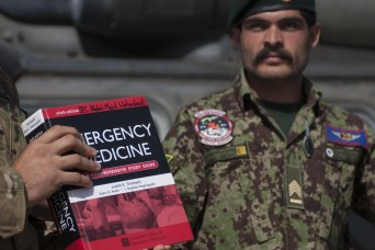 The Kandahar Air Wing added two trainers to its team of flight medics after a culminating exercise and graduation ceremony, Jan. 16, 2013, at Kandahar Airfield, Afghanistan, marking the completion of a four-week course administered by their partners...