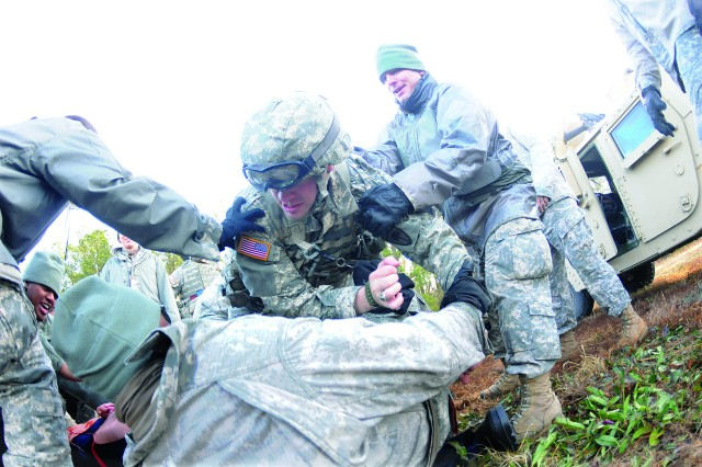 Second Lt. Ben Rymer scuffles with villagers after he and members of his squard attempted to recover a body during BOLD FTX held at the Fort Lee complex Jan. 9. The scenario was one of several in which students were required to take on duties typically performed by enlisted personnel.