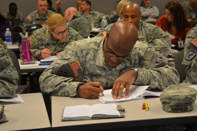 More than 300 participants, trainers and support staff arrived at Fort Bliss, Texas, as part of Joint Contracting Readiness Exercise 2013, the U.S. Army Contracting Command's annual contingency contracting readiness exercise. Maj. Anthony Hughley, U.S. Army Corps of Engineers, Washington, D.C., takes notes during the introductory session of the exercise.