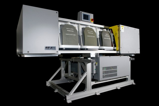 Armor plates made of ceramic can be prone to cracking, so finding the best solution for testing them became a challenge for Picatinny scientists who were sought out for their expertise. The Armor Inspection System, pictured here, was the answer.