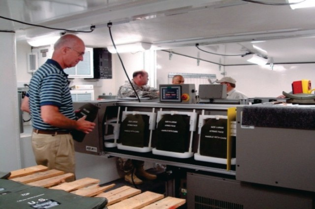 The Armor Inspection System performs tests on small arms protective insert plates overseas.