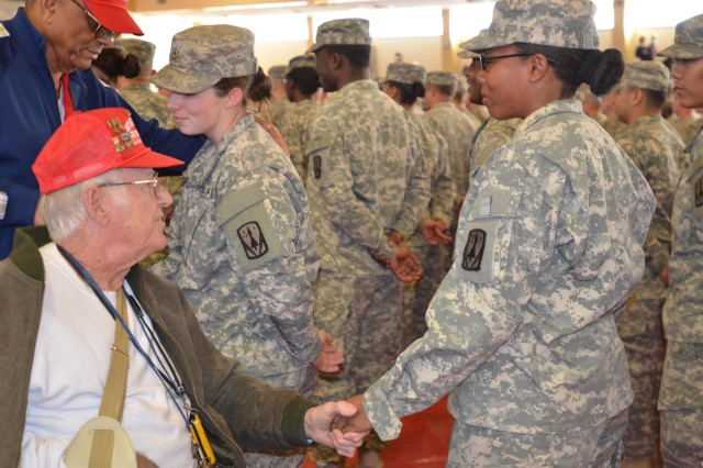 Veterans wish Soldiers in 3rd Battalion, 2nd Air Defense Artillery safe travels after a deployment ceremony at Rinehart Fitness Center.