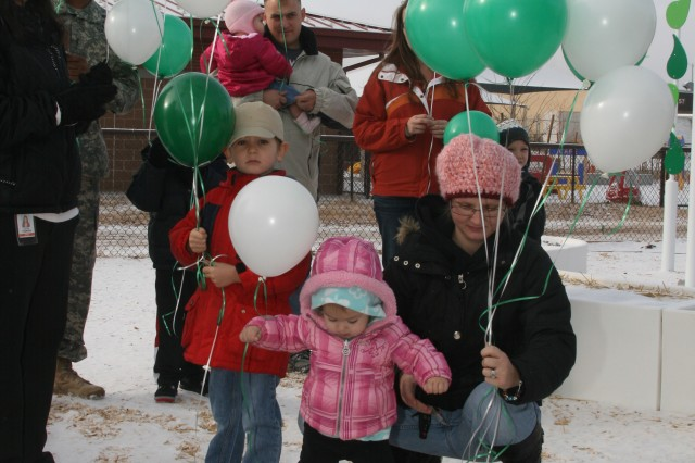 FORT CARSON, Colo. -- Parents, children and teachers gather outside the Fort Carson Head Start Center Monday to release green and white balloons in honor of the one-month anniversary of the Sandy Hook Elementary School shootings.
