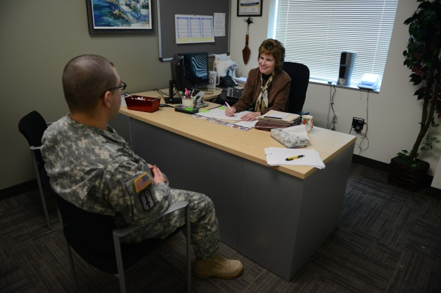 Spc. Victor Gabaldon, Warrior Transition Battalion, receives advice from Eleanor McKennan, his Warrior Transition Battalion nurse case manager, at Fort Carson, Colo.