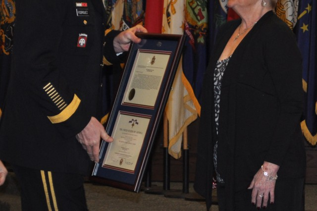 Gen. David Rodriguez, the commander of U.S. Army Forces Command (FORSCOM), presents the Distinguish Service Cross to the mother of Staff Sgt. Eric Shaw. Shaw was posthumously awarded the second highest military award for valor that can be given to a service member, based on Shaw's actions while serving as a squad leader with 1st Brigade, 101st Airborne Division, in Kunar Province, Afghanistan, in June 2010.