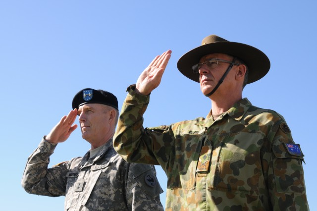 Maj. Gen. Roger Mathews (right), deputy commanding general, U.S. Army Pacific, hosted a Flying V ceremony for MAJGEN Richard Maxwell Burr (right), USARPAC deputy commanding general of operations from the Australian Defense Forces render a salute Jan. 17 at historic Palm Circle, Fort Shafter. The Flying V ceremony traditionally welcomes or honors senior Army officials when they assume duties or depart from an Army command. Its name refers to the V shape in which the colors are posted during the ceremony. USARPAC is the first Army Service Component Command to have coalition partner general officer to serve in the position of deputy commanding general.