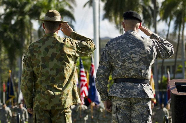 Maj. Gen. Roger Mathews (right), deputy commanding general, U.S. Army Pacific, hosted a Flying V ceremony for MAJGEN Richard Maxwell Burr (left), USARPAC deputy commanding general of operations from the Australian Defense Forces render a salute during Jan. 17 at historic Palm Circle, Fort Shafter. The Flying V ceremony traditionally welcomes or honors senior Army officials when they assume duties or depart from an Army command. Its name refers to the V shape in which the colors are posted during the ceremony. USARPAC is the first Army Service Component Command to have coalition partner general officer to serve in the position of deputy commanding general.