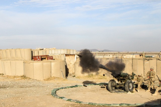 "KHOWST PROVINCE, Afghanistan "" A howitzer team assigned to Battery B, 3rd Battalion, 320th Field Artillery Regiment, 3rd Brigade Combat Team ""Rakkasans"", 101st Airborne Division (Air Assault), fires their M119A2 Howitzer during a live-fire exercise at Camp Clark, Afghanistan, Jan. 14, 2013. The 105mm was shot in support of a training mission to certify forward observers from the 1st Squadron, 33rd Cavalry Regiment. (U.S. Army photo by Spc. Brian Smith-Dutton, Task Force 3/101 Public Affairs)"