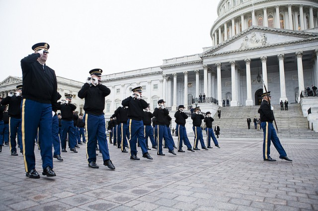 Members of the 3d U.S. Infantry Regiment (The Old Guard) Fife and Drum Corps march past the U.S. Capital building during a dress rehearsal a pass and review, Jan. 13, 2013, in preparation for the presidential inauguration. The 57th presidential inauguration will take place Jan. 21, 2013.