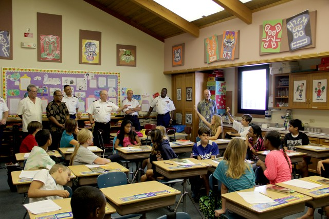 Lt. Gen. Richard Formica, back center, asks fifth-grade students questions about the perks and challenges of living on Kwajalein when he toured Kwajalein Schools Jan. 16.