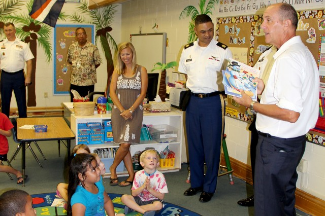 U.S. Ambassador to the Republic of the Marshall Islands, Thomas Armbruster, talks to the Kwajalein kindergarten class about the importance of reading books.
