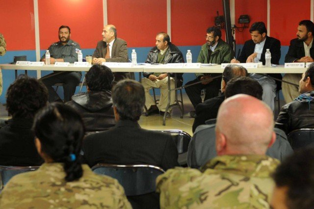 Capt. Amanda Presson introduces Afghan officials who visited the Afghanistan Captured Material Exploitation lab on Kandahar Airfield, Jan. 16, 2013. The panel included judges, prosecutors and Afghan uniformed police. (U.S. Army photo by Sgt. Ashley Bell)