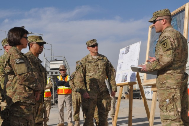 Lt. Col. Stanley J. Sliwinski, Jr., (center) AFSBn-Kandahar, 401st Army Field Support Brigade commander, looks on as Capt. Lee W. Berry, AFSBn-KAF S-3 (Operations) briefs the Honorable Heidi Shyu, assistant secretary of the Army for acquisitions, logistics and Technology, and Gen. Dennis L. Via, Army Materiel Command commanding general, on battalion missions Jan. 16 at the theater vehicle maintenance facility which will serve as the KAF RPAT yard when the battalion moves into the facility which is currently under construction.