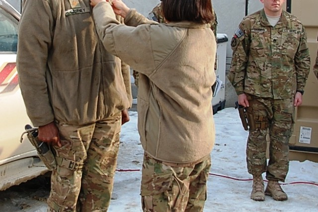 The Honorable Heidi Shyu, assistant secretary of the Army for acquisitions, logistics, and technology, presents a Bronze Star Medal to Maj. Myrone B. Gaffney during an awards ceremony at Bagram Airfield Jan. 15.