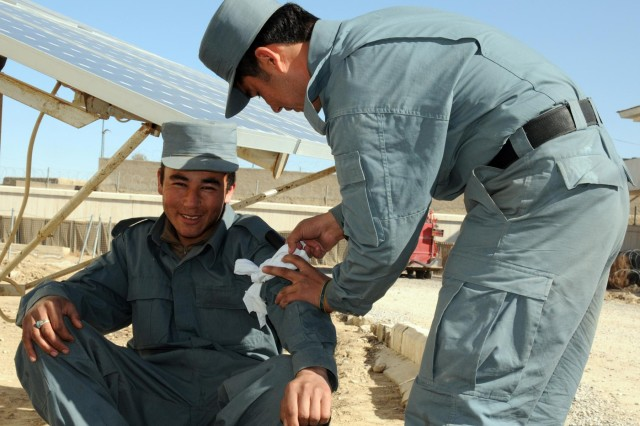 Afghan Uniformed Police members make improvised tourniquets during a medical training event, Jan. 19, 2013, at the District Police Headquarters in Spin Boldak, Afghanistan. The AUP unit received medical classes from Security Force Assistance Team Tombstone comprised of Soldiers from the 56th Infantry Brigade Combat Team of the Texas Army National Guard.