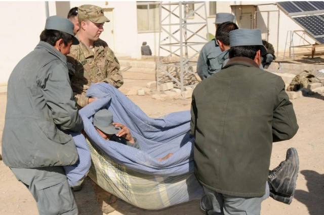 Sgt. David A. Hixson, a medic from Arlington, Texas, with Security Force Assistance Team Tombstone, assists Afghan Uniformed Police members carry a simulated casualty in an improvised litter during a medical training exercise, Jan. 19, 2013, at the District Police Headquarters in Spin Boldak, Afghanistan. SFAT Tombstone is comprised of members from the 56th Infantry Brigade Combat Team of the Texas Army National Guard.