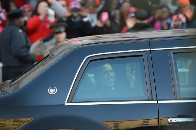 President Obama waves to the crowd from his limo during the Inaugural Parade, Jan. 21, 2013.
