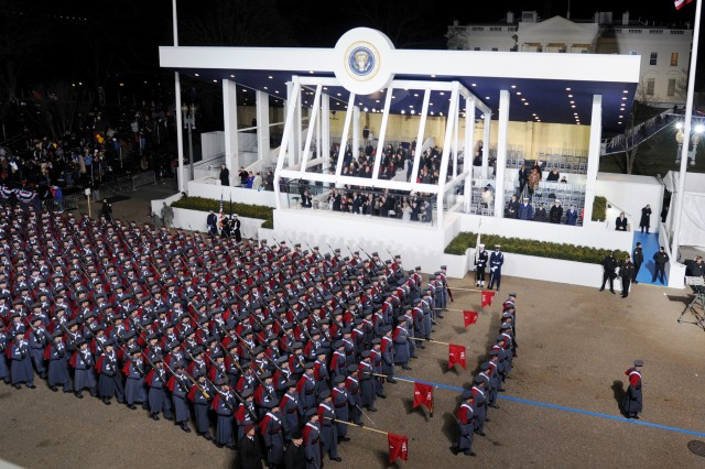A formation from Virginia Military Institute passes the presidential reviewing stand at the White House during military support for the 57th Presidential Inauguration, Jan. 21.