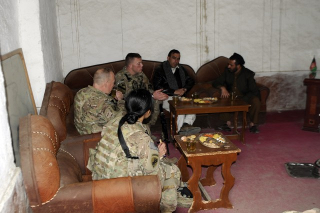 """FORWARD OPERATING BASE FENTY, Afghanistan """" Soldiers of Provincial Reconstruction Team Nangarhar, based at Forward Operating Base Finley-Shields, Afghanistan,  sit with the leaders of Lal Pur District during a key leader engagement,  Jan. 12, 2013. (U.S. Army Photo by Sgt. Jon Heinrich)"""