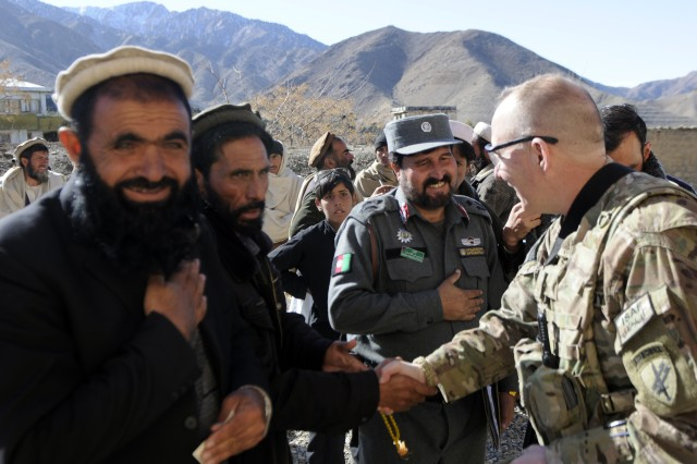 """FORWARD OPERATING BASE FENTY, Afghanistan """" U.S. Army Maj. Jeff D. Houston, from 414th Civil Affairs Battalion, and executive officer with Provincial Reconstruction Team Nangarhar, shakes hands with the leaders of the Dur Baba District after conducting a key leader engagement, Jan. 13, 2013. (U.S. Army Photo by Sgt. Jon Heinrich)"""