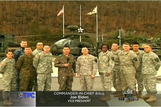 A group of U.S. and South Korean troops speak with Vice President Joe Biden during the Commander-in-Chief Ball from Camp Casey, South Korea.