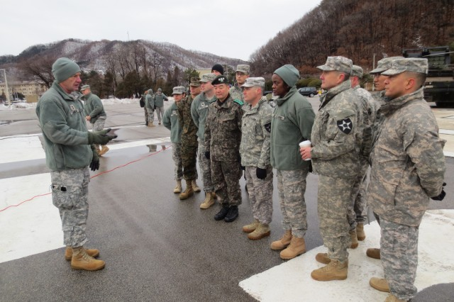 Maj. Gen. Edward Cardon, commander of the 2nd Infantry Division, speaks to U.S. and South Korean troops before they participate in the Commander-in-Chief Ball live via satellite from South Korea.