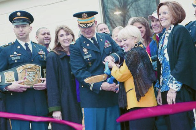 Fort Meade Garrison Commander, COL Ed Rothstein is joined by USO-Metro Washington President Elaine Rogers and many more for the official grand opening of Fort Meade's new USO Center.
