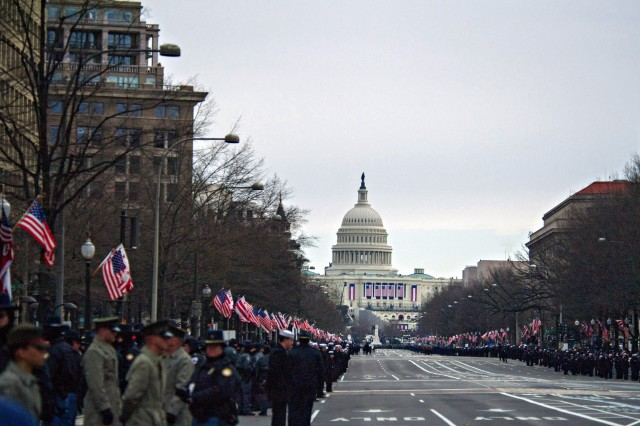 """U.S. Army Soldiers participate in the Presidential Inauguration Parade, which included Soldiers from the 3rd Infantry Regiment """"The Old Guard,"""" The U.S. Army Field Band, The U.S. Army Band """"Pershing's Own,"""" the Old Guard Fife and Drum Corps and Soldiers from the 1st Battalion, 319th Airborne Field Artillery Regiment, 3rd Brigade Combat Team, 82nd Airborne Division, who marched west along Constitution Avenue to Pennsylvania Avenue to the White House in Washington, D.C.,  Jan. 21, 2013."""