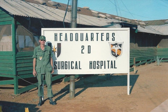 "Capt. George ""Noel"" Crawford poses in front of 2nd Surgical Hospital in Chu Lai, South Vietnam around October 1967."