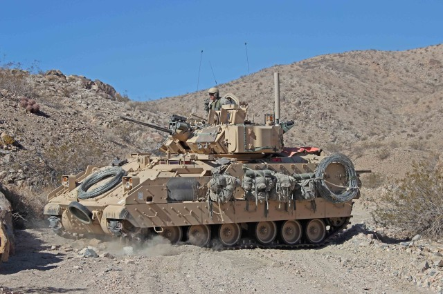 U.S. Army Soldier from the 3rd Armored Brigade Combat Team, 1st Cavalry Division, Fort Hood, Texas scans the desert area from an M2 Bradley Infantry Fighting Vehicle during Decisive Action rotation 13-03 on Jan. 19, 2013 at the National Training Center in Fort Irwin, Calif. Decisive Action rotations are geared toward an adaptive enemy in a complex environment. (U.S. Army photo by Sgt. Eric M. Garland)
