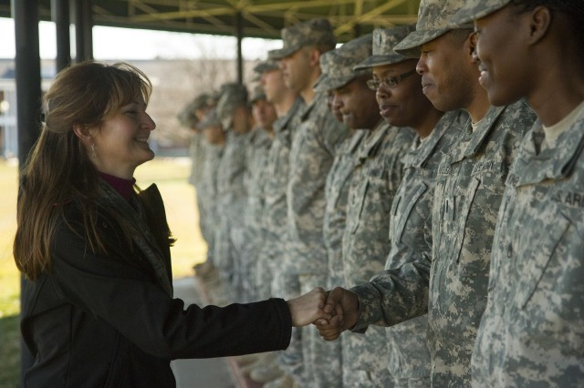 Denise Lambert, wife of Command Sgt. Maj. James Lambert, the Interim Command Sergeant Major of the Army Reserve, greets Army Soldiers representing 11 major subordinate commands of the USARC during a rehearsal at Fort Myer, Va., Jan. 20 in preparation for the 57th Presidential Inauguration parade scheduled for Jan. 21.  (Army Reserve photo by Sgt. 1st Class Mark Bell)