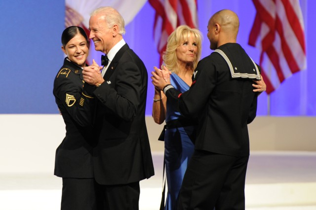 Vice President Joe Biden dances with Army Staff Sgt. Keesha N. Dentino as his wife Jill Biden dances with Navy Petty Officer 3rd Class Patrick Figueroa at the Commander-in-Chief Inaugural Ball, Jan. 21, 2013, in Washington, D.C.
