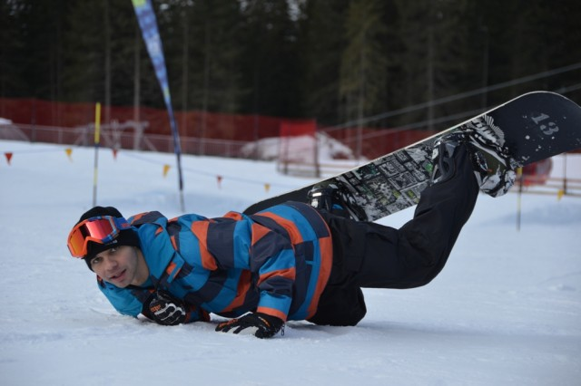 Jonathon Torres learns how to take a fall during a ODR snowboarding class.