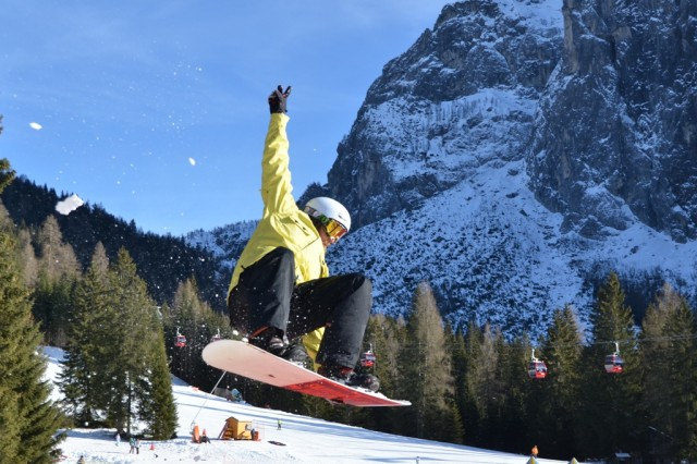 Chris Wolff, Vicenza Outdoor Recreation snowboard instructor, flies off a jump.