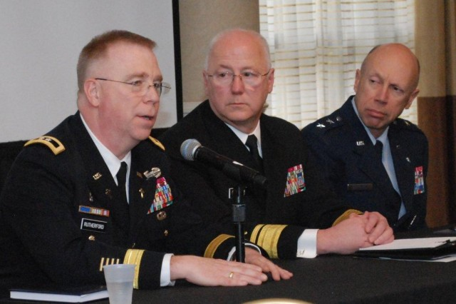 U.S. Army Chief of Chaplains, Maj. Gen. Donald Rutherford (seated left), participates in a panel discussion with military chaplain endorsers.  Seated next to Maj. Gen. Rutherford are the Chief of Chaplains of the United States Navy, Rear Admiral Mark L. Tidd, (center), and the Chief of Chaplains of the U.S. Air Force, Maj Gen Howard D. Stendahl, (right).   Photo provided by Christianne M. Witten.