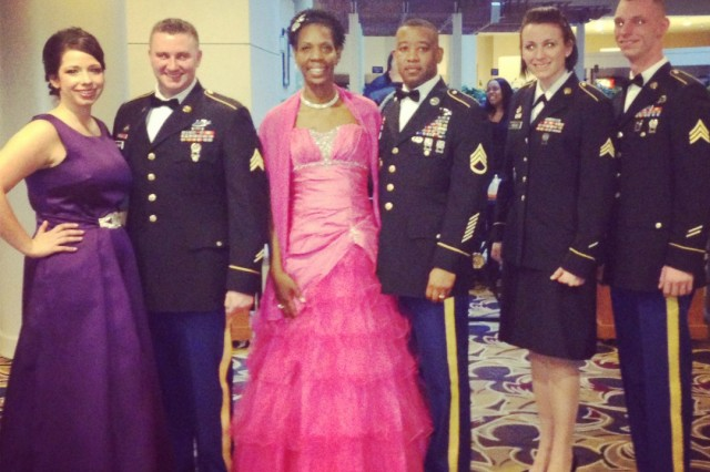 Soldiers from First Army Division East, along with their guests, pose for a photo before attending the Commander in Chief Ball, January 21, in Washington, D.C.