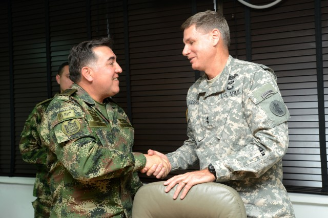 "BOGOTA, Colombia "" Maj. Gen. Frederick S. Rudesheim (right), U.S. Army South commanding general, greets Maj. Gen. Javier Enrique Rey (left), the Colombian army director of operations, at the Colombian military headquarters in Bogota, Colombia Jan. 22. (U.S. Army photo by Robert R. Ramon, U.S. Army South Public Affairs)"