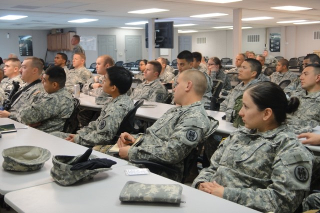 Soldiers of the 352nd Military Police Company and 382nd Military Police Detachment participate in classroom C-IED instruction.