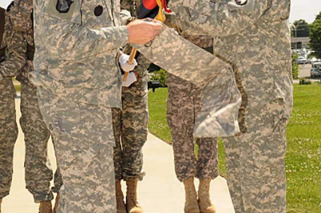 Then Maj. Gen. John F. Campbell, former commander of the 101st Airborne Division, and Command Sgt. Maj. Scott Schroeder, former division command sergeant major, case the division colors during the color-casing ceremony outside of McAuliffe Hall at Fort Campbell, Ky., May 19, 2010, prior to the division's last deployment to Afghanistan.