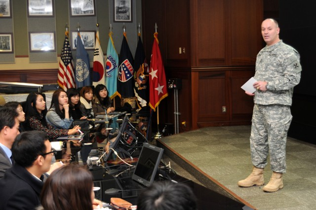 Maj. Gen. Walter M. Golden welcomes student goodwill ambassadors to the Eighth Army Headquarters at Yongsan Garrison, South Korea, Jan. 23, 2013.