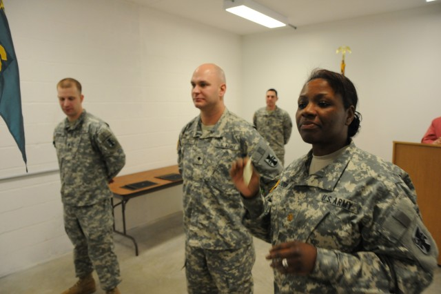 Maj. Mary L. Olodun, commander of 326th Mobile Public Affairs Detachment, 314th Public Affairs Operation Center, 412th Theater Engineer Command, speaks with her Soldiers about the importance to lead during a promotion ceremony Nov. 17, 2012, at the Reading Reserve Center in Reading, Pa.
