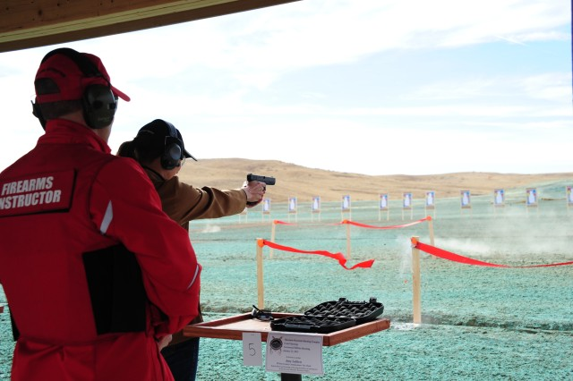 FORT CARSON, Colo. -- El Paso County Commissioner Amy Lathen participates in the Cheyenne Mountain Shooting Complex ribbon shooting ceremony, officially opening the facility Wednesday.